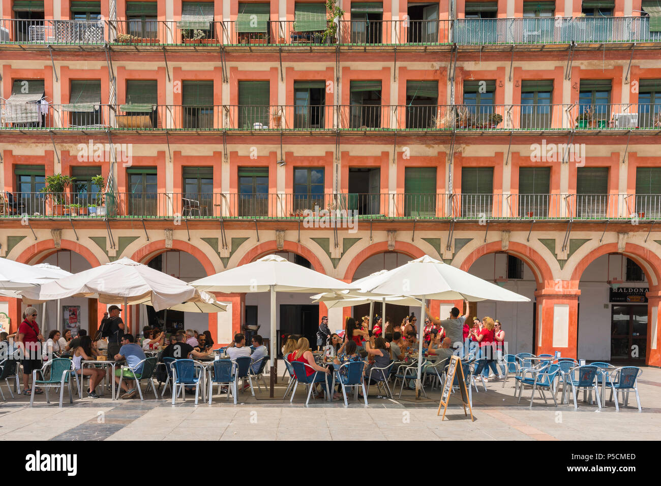 Cordoba Spain, view of a cafe terrace in the 17th Century Plaza de la Corredera in the center of Cordoba on a summer afternoon, Andalucia, Spain. Stock Photo