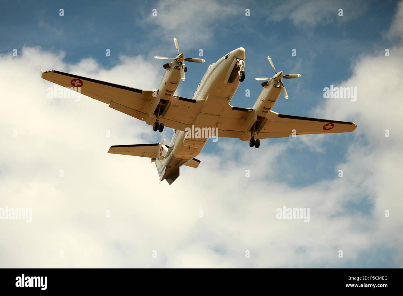 aircraft landing at an airport - Stock Image