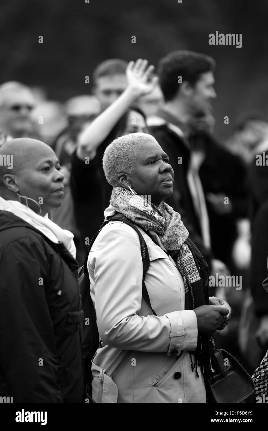 Candid Monochrome image of two black women at the 2018 Africa Oye music festival in Sefton Park, Liverpool. - Stock Image