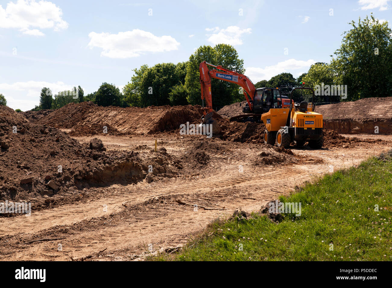 Heavy Earth Moving Equipment being used by contractors  to make a new car park area in Beckenham Place Park,  Lewisham - Stock Image