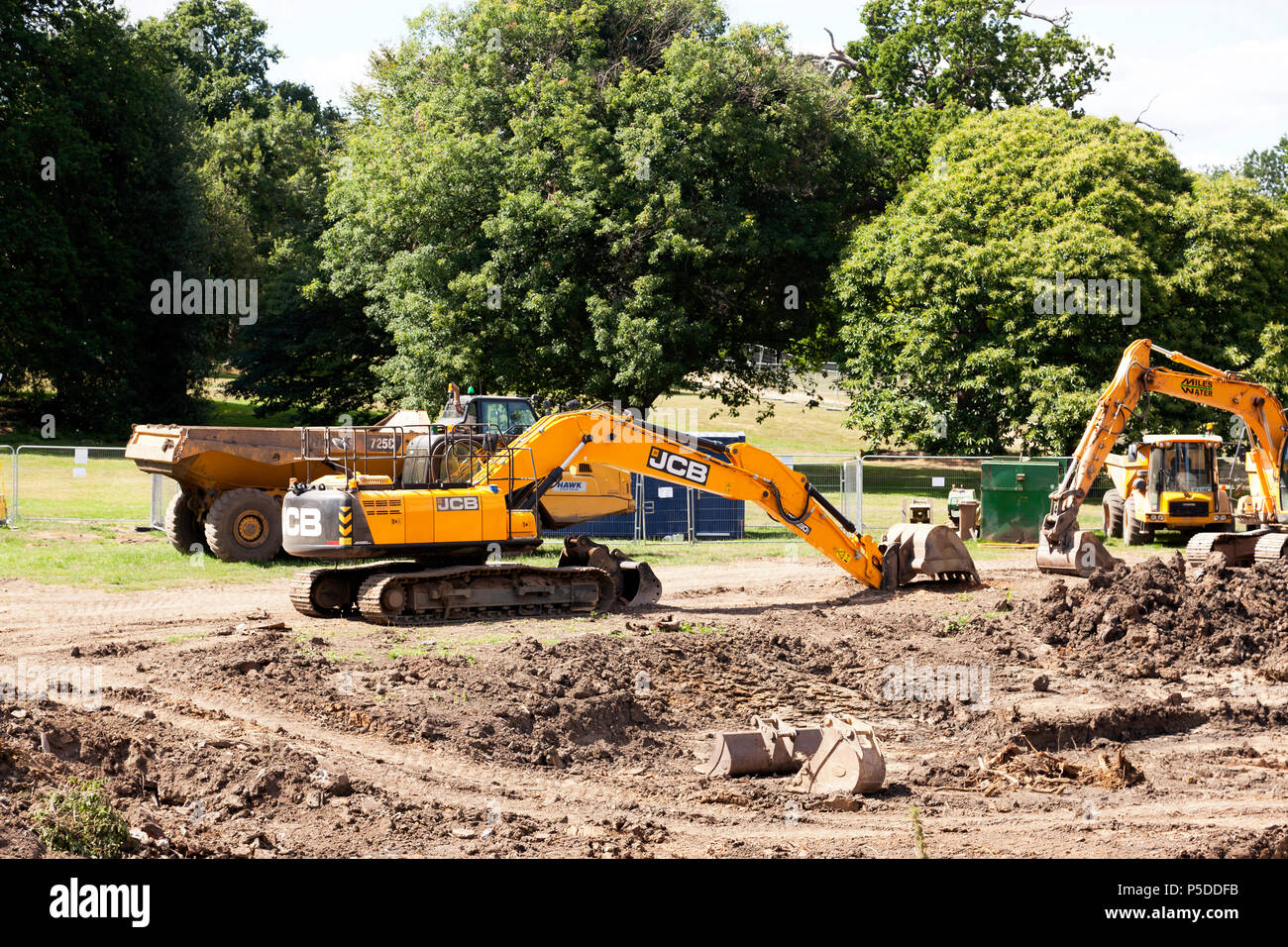 Heavy Earth Moving Equipment being used to dig out  a new Lake in Beckenham Place Park, Lewisham - Stock Image