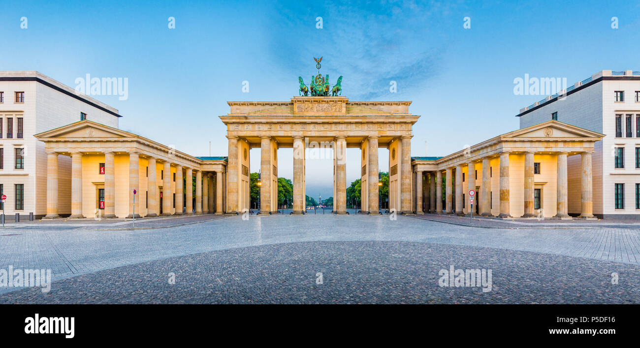 Panoramic view of famous Brandenburger Tor (Brandenburg Gate), one of the best-known landmarks and national symbols of Germany, in beautiful golden mo - Stock Image