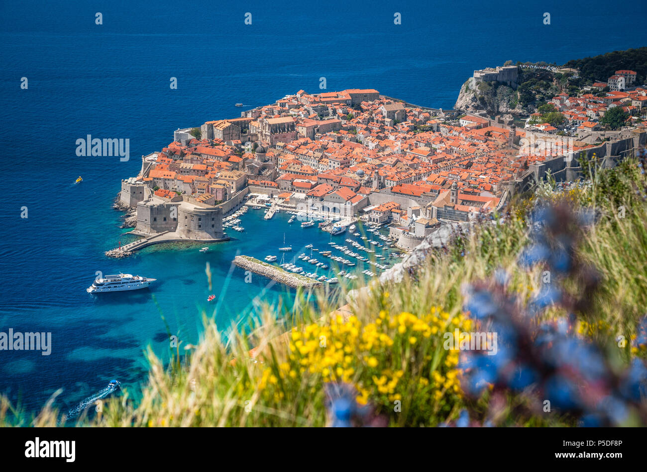 Panoramic aerial view of the historic town of Dubrovnik, one of the most famous tourist destinations in the Mediterranean Sea, from Srd mountain - Stock Image