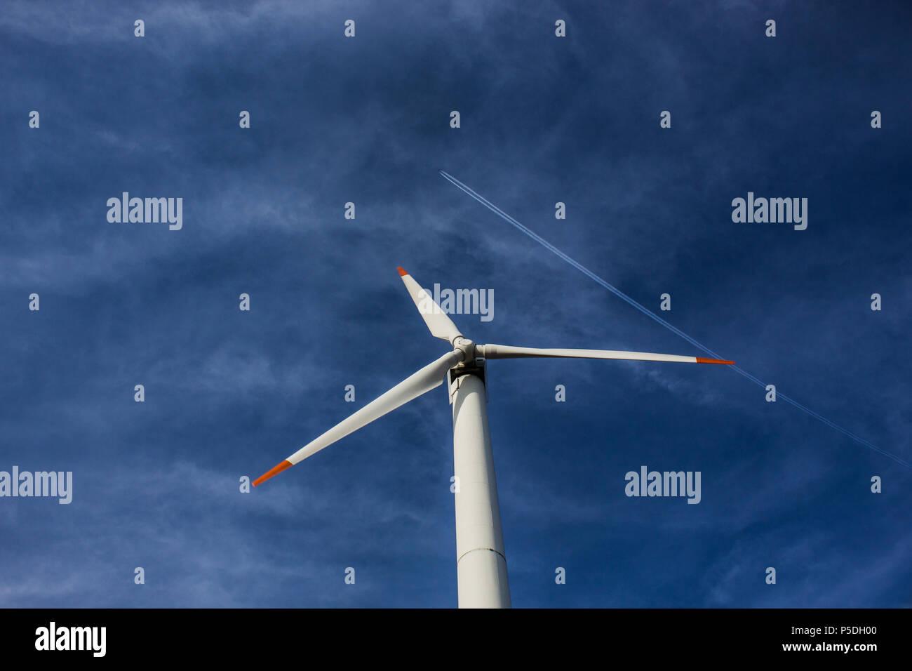 Renewable Energy Vs. Fossil Fuel. Contrast contrast between fossil fuel energy and wind energy. - Stock Image