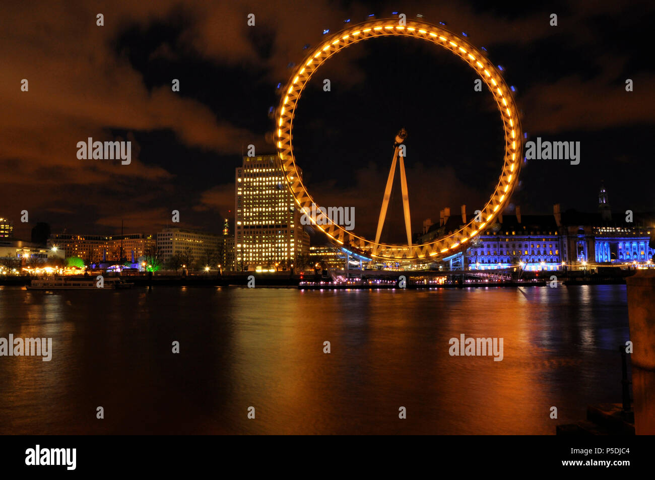 A colourful nighttime shot of the London eye Stock Photo