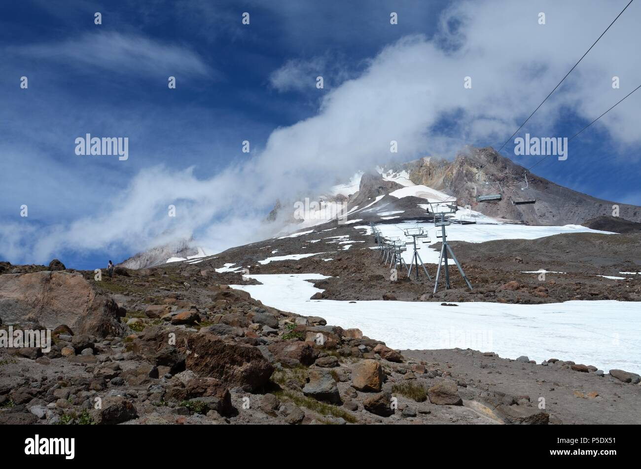 Mt. Hood in Oregon in August, with the chairlift that provides access to the  snowfield providing the longest ski season in the United States - Stock Image