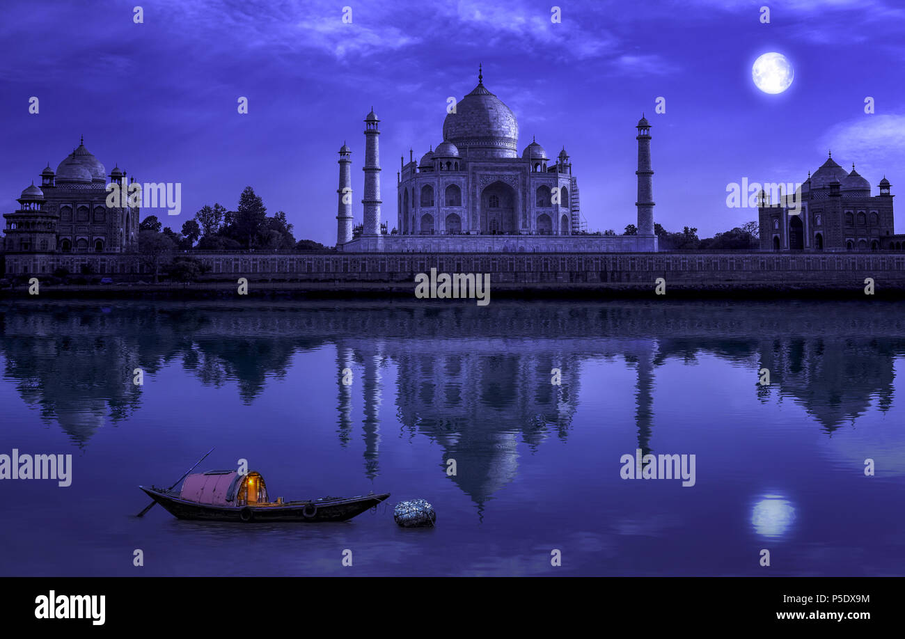 Taj Mahal Agra in full moon night with wooden boat on river Yamuna. Photograph shot from Mehtab Bagh. Stock Photo