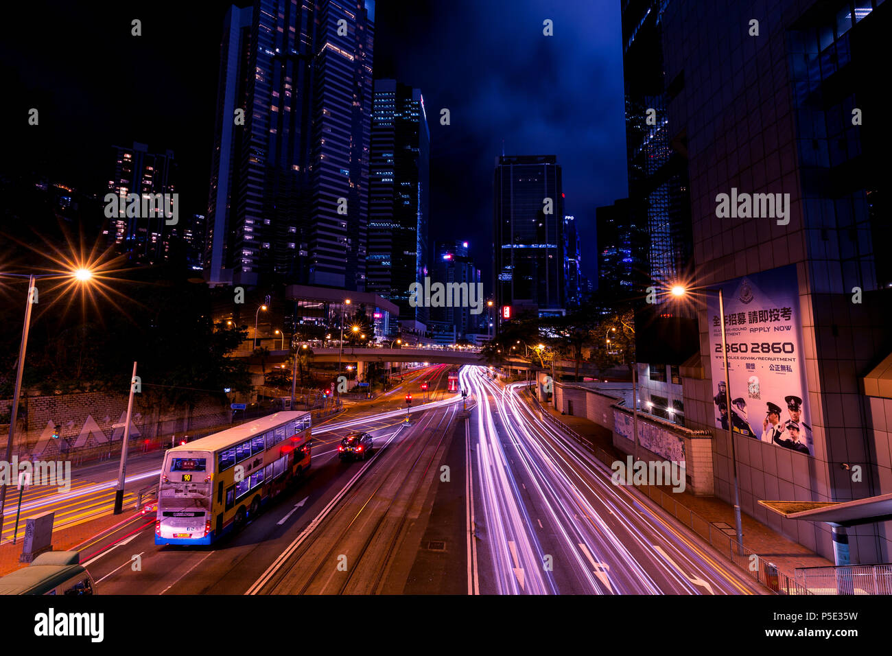 HONG KONG - JUNE 02, 2018: Light trails of traffic at night in central Hong Kong Stock Photo