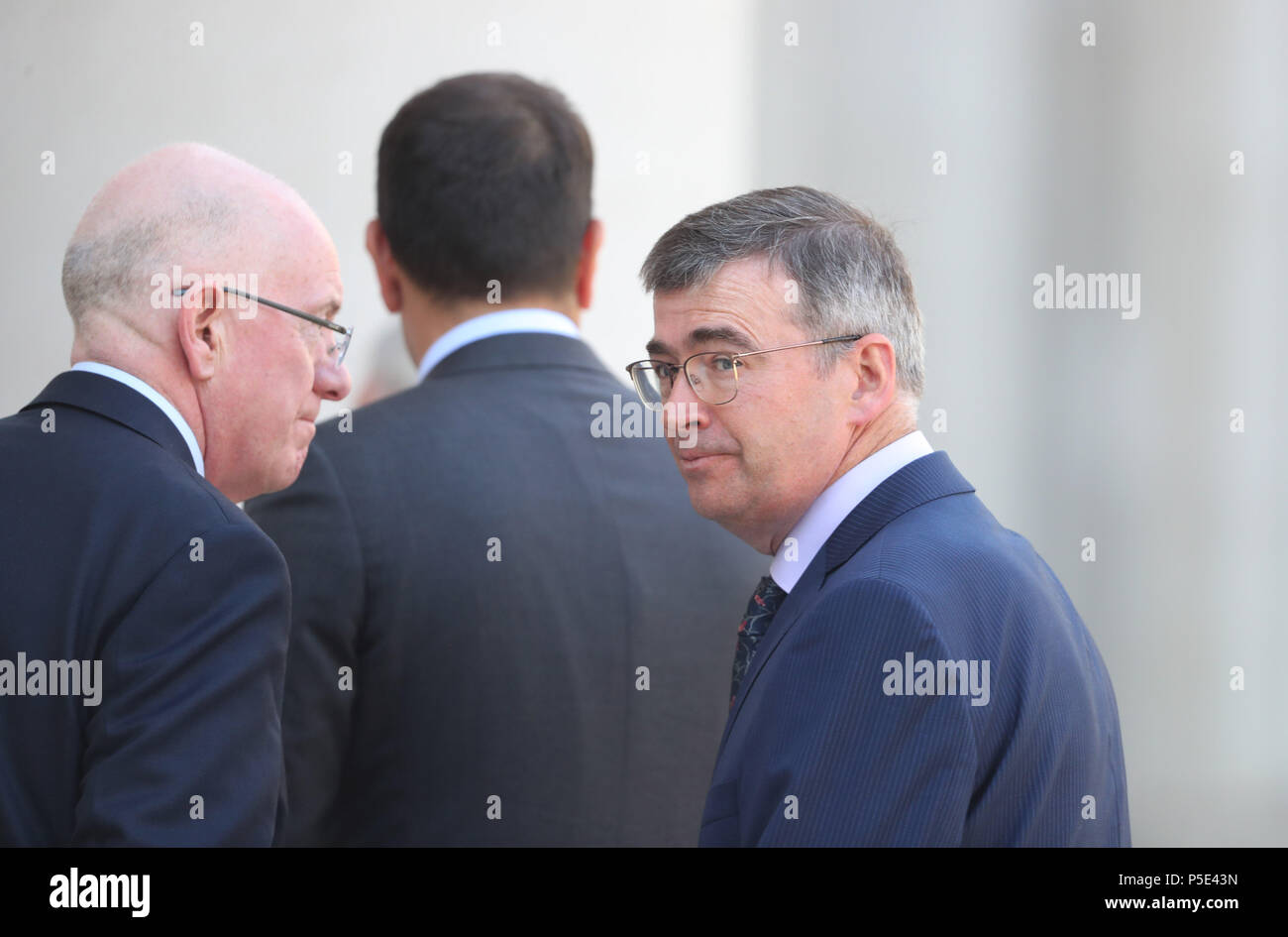 Taoiseach Leo Varadkar (centre)and Justice Minister Charles Flannigan (left) at the announcement of Drew Harris (right) as the new Garda Commissioner at the government buildings in Dublin. - Stock Image