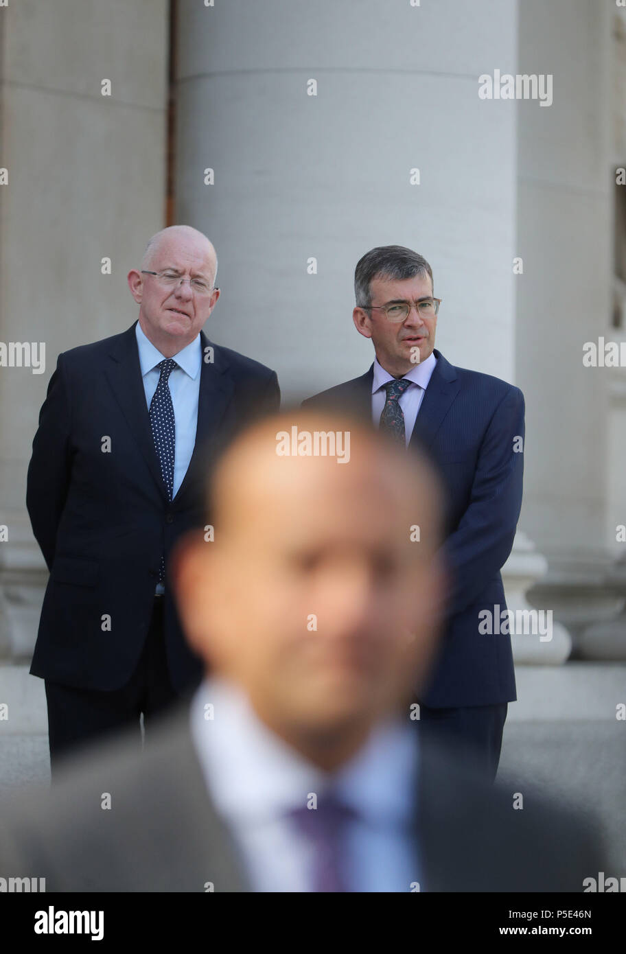 Justice Minister Charles Flannigan (left) at the announcement of Drew Harris (right) as the new Garda Commissioner with Taoiseach Leo Varadkar (front) speaking to the media at the government buildings in Dublin. - Stock Image