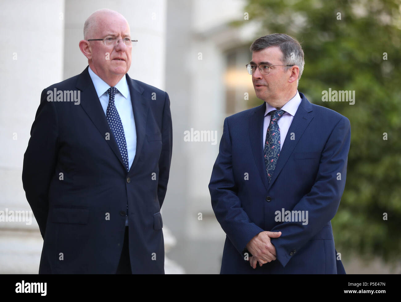 Justice Minister Charles Flannigan (left) at the announcement of Drew Harris (right) as the new Garda Commissioner at the government buildings in Dublin. - Stock Image
