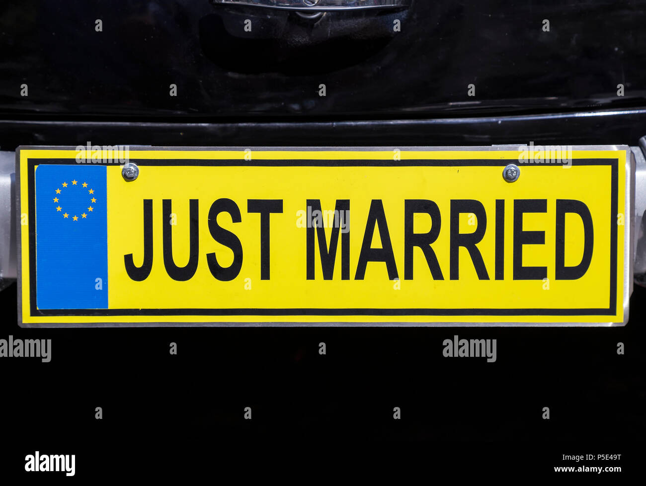 Just Married Euro License Plate On Retro Wedding Car Stock Photo