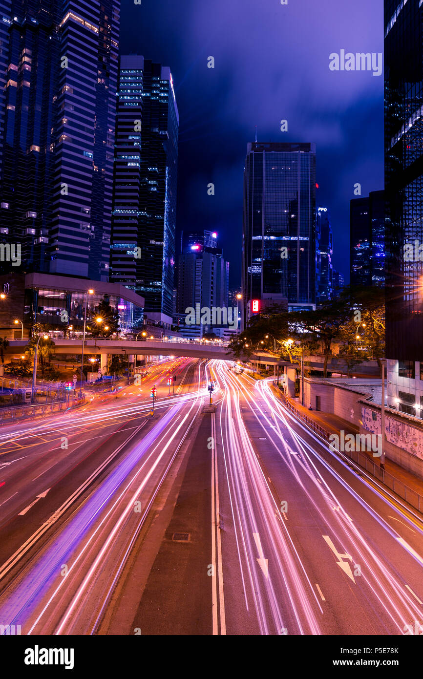 HONG KONG - JUNE 02, 2018: Light trails of traffic at night in central Hong Kong Stock Photo