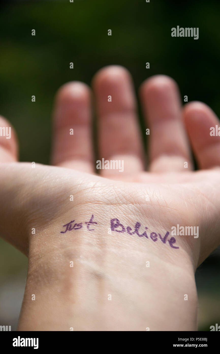 Do it yourself tattoo stock photos do it yourself tattoo stock handwritten motivational phrase on the human hand just believe stock image solutioingenieria Image collections