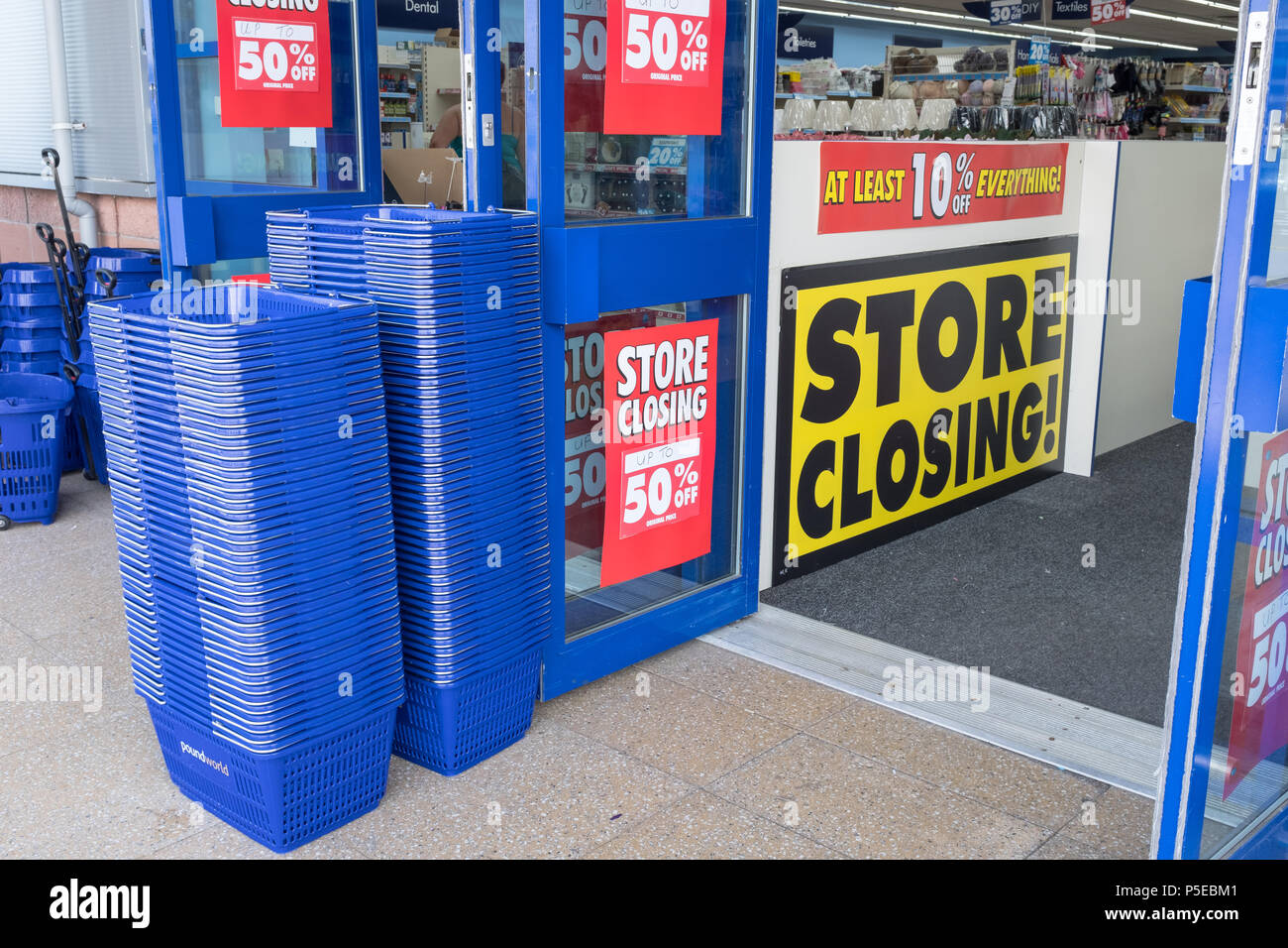 View of the front entrance to the poundworld plus store in Dumfries which is closing down and goods are being sold at a reduced price. - Stock Image