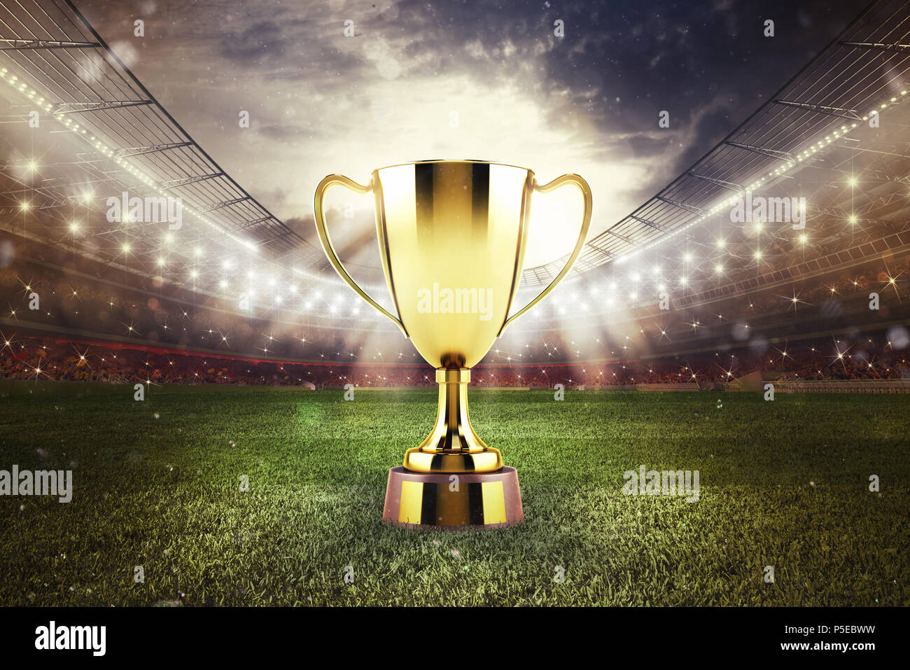 Golden winner s cup in the middle of a stadium with audience Stock Photo