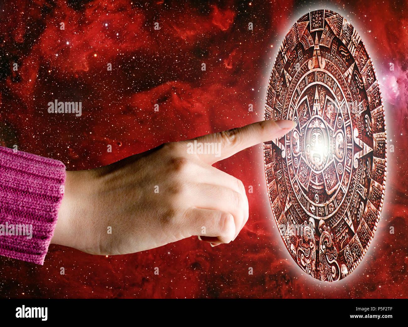 hand touching the Aztec stone calendar - Stock Image