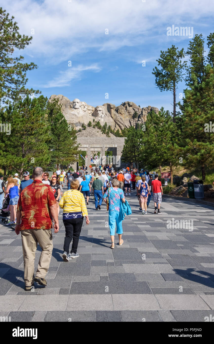 MOUNT RUSHMORE, KEYSTONE, SOUTH DAKOTA, USA - JULY 20, 2017: Visitors walk along the Avenue of Flags with Mount Rushmore in the background Stock Photo