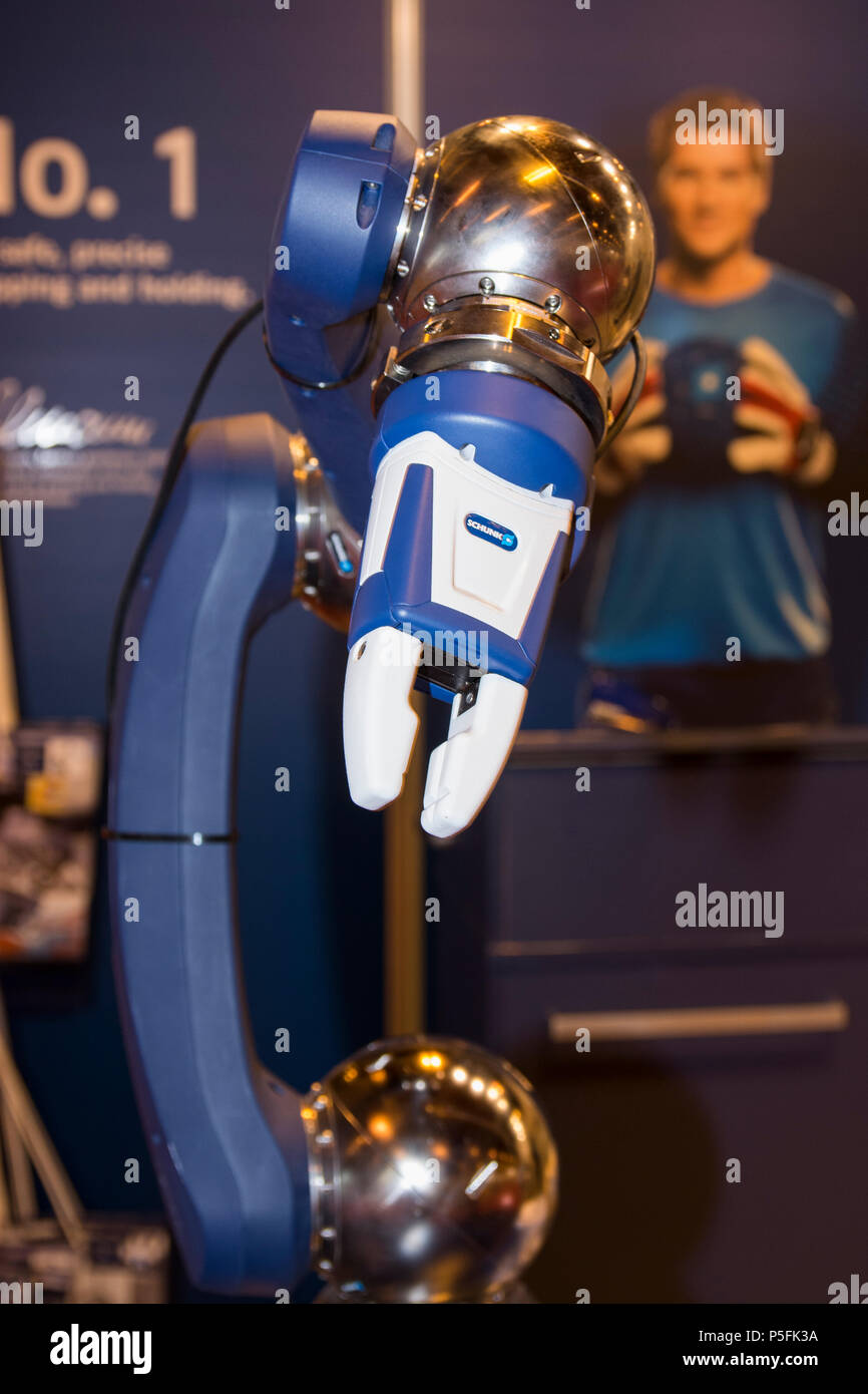 Co-act EGP-C collaborative robotic supliers for robotic arm from Schunk. Behind in the poster: Jens Lehmann, the Arsenal's goalkeeper. - Stock Image