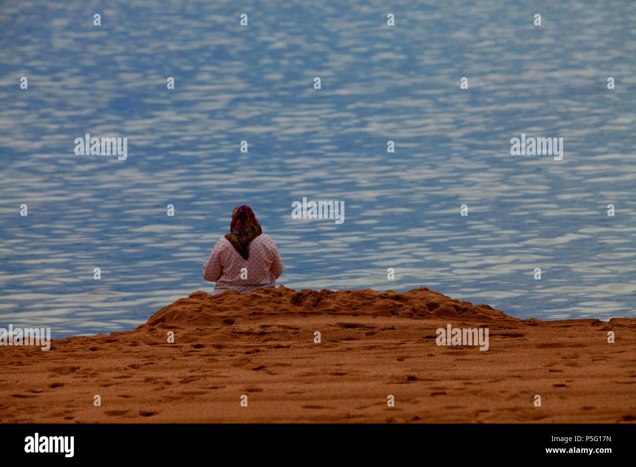 Woman by the Sea Stock Photo