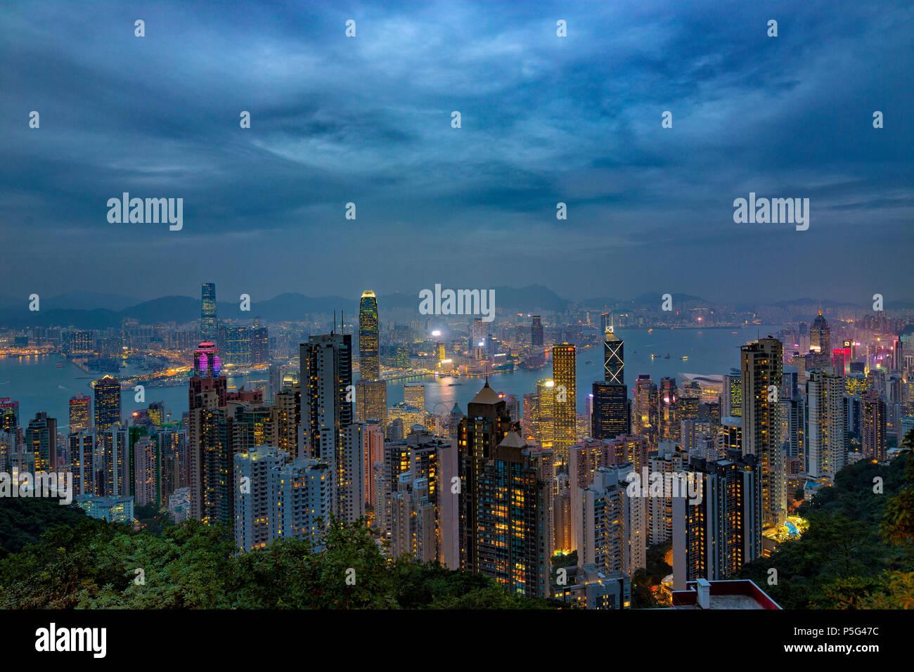 HONG KONG - NOV 6: Neon lights of Hong Kong on November, 6, 2017. Evening skyline from The Peak Stock Photo