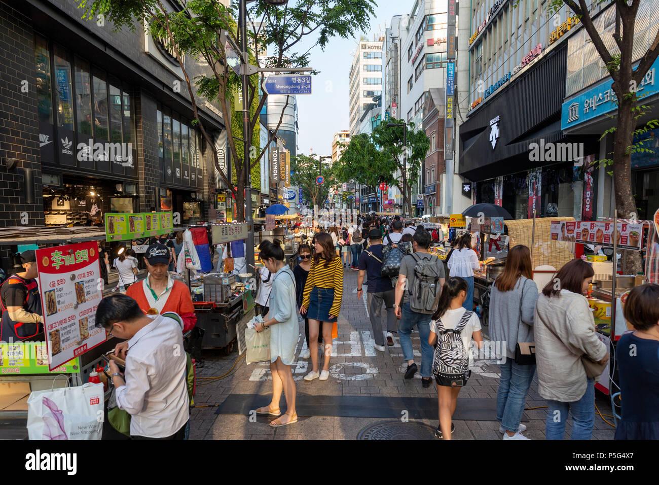SEOUL, KOREA - MAY 28, 2018 : Myeong-Dong shopping street, Korean people buying and shopping at food stalls Stock Photo