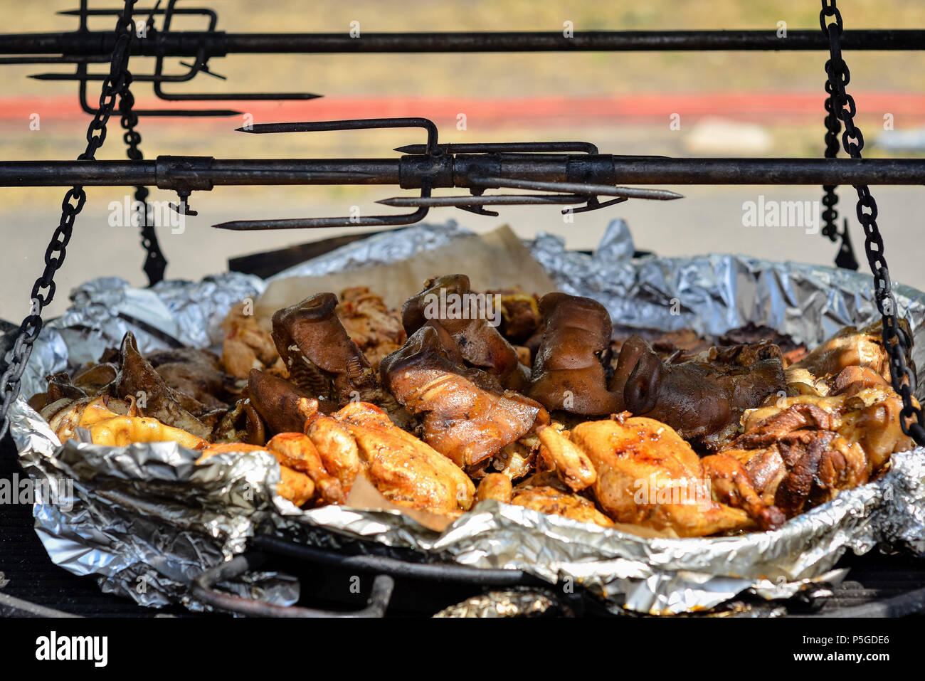 Different fried and grilled meat on a large pan. Stock Photo