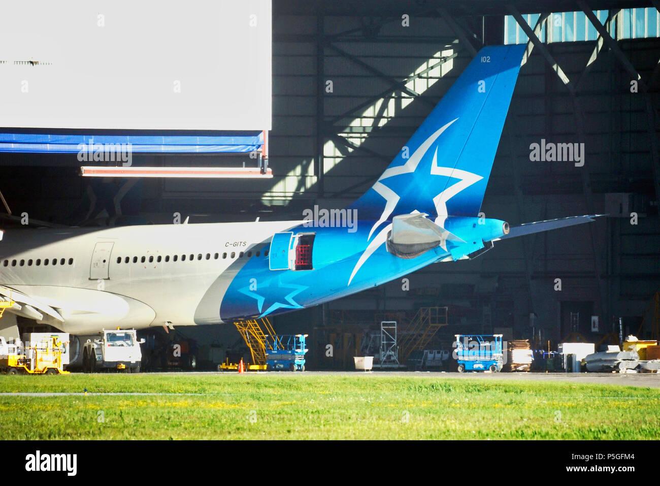 Montreal,Canada, 25 June 2018. Air Transat passenger jet in its maintenance hanger at Trudeau International airport.Credit:Mario Beauregard/Alamy Live - Stock Image