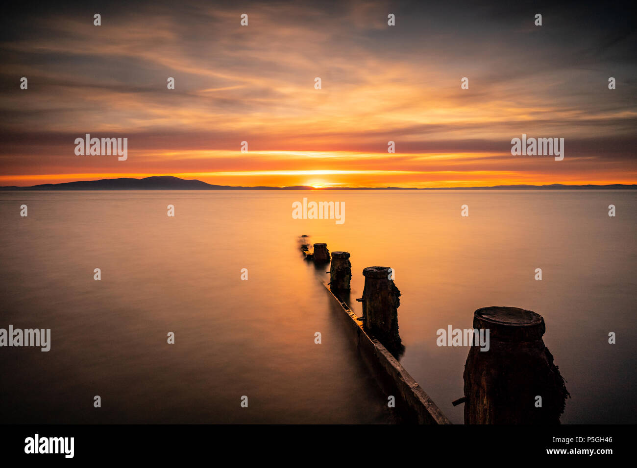 Sunset over Scotland from Silloth, Cumbria. - Stock Image