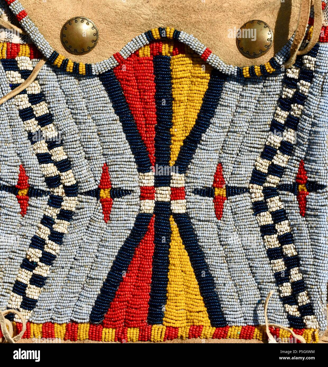 Close up of traditional Native American designed bead pattern on hand crafted pouch on display at Bloody Lake Rendezvous, Woodford, Wisconsin, USA Stock Photo