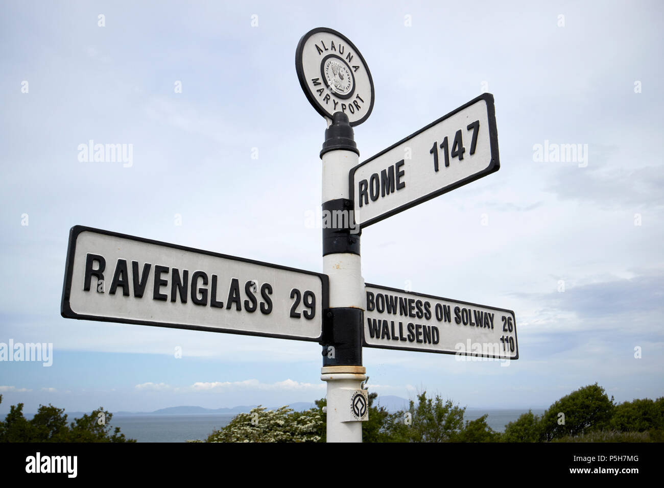 distance marker at the old roman fort of alauna in Maryport Cumbria England UK with distances to hadrians wall ends and rome - Stock Image