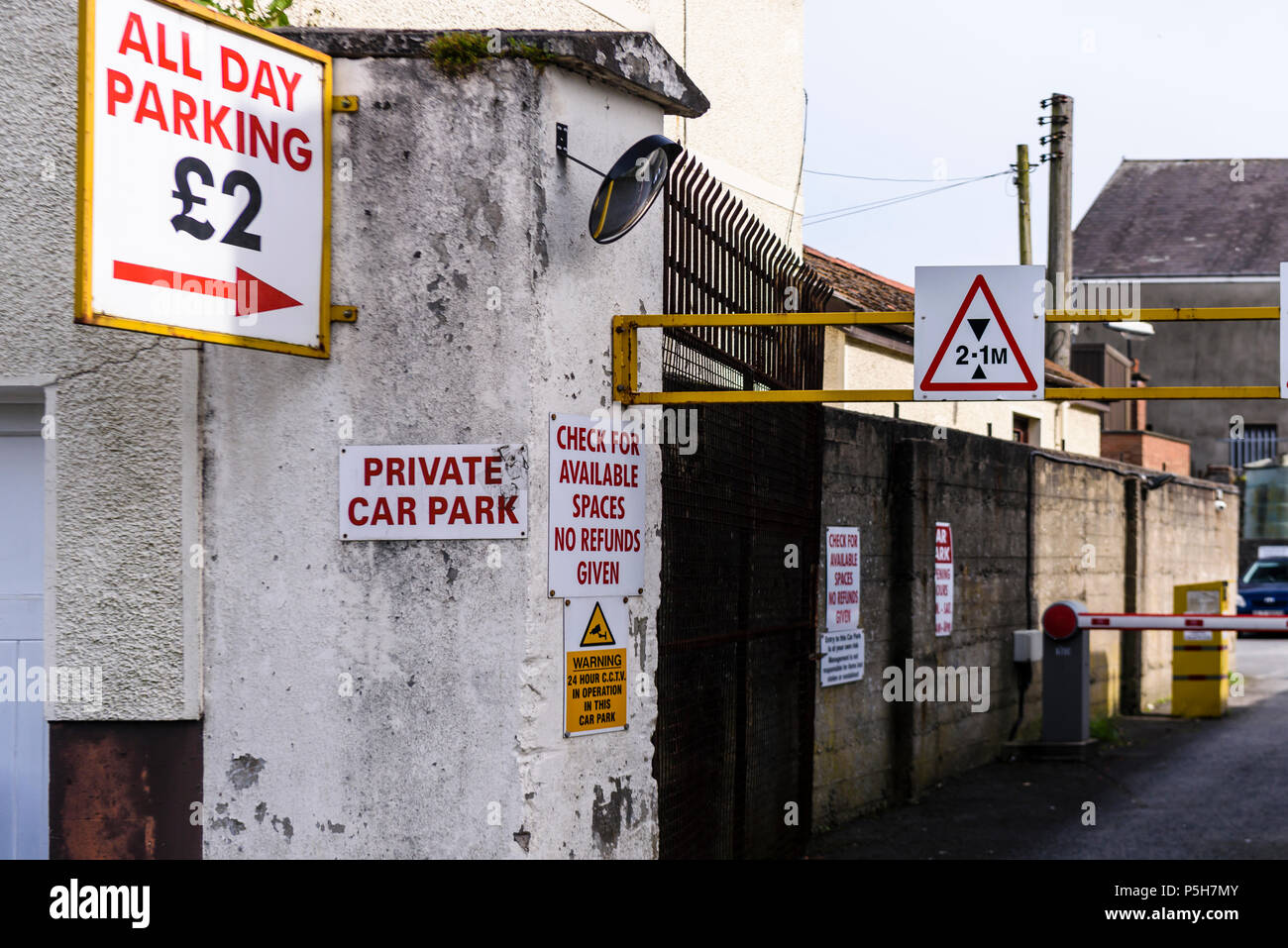 Entrance to a private car park, with sign saying 'All Day Parking £2' - Stock Image