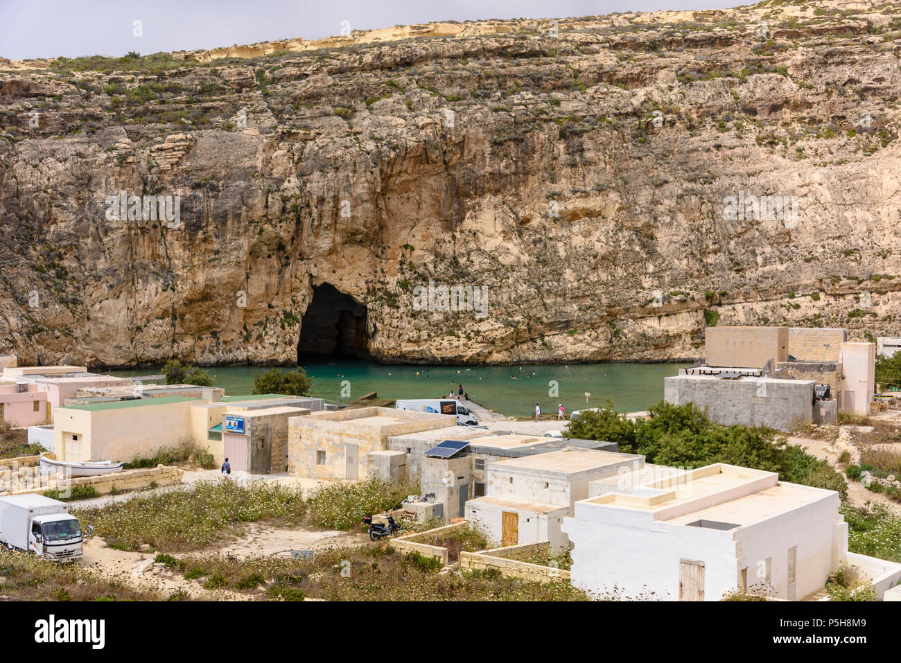 Dwerja, the inland sea, Gozo, Malta.  The cave joins with the Mediterranean sea on the other side of the cliff. Stock Photo