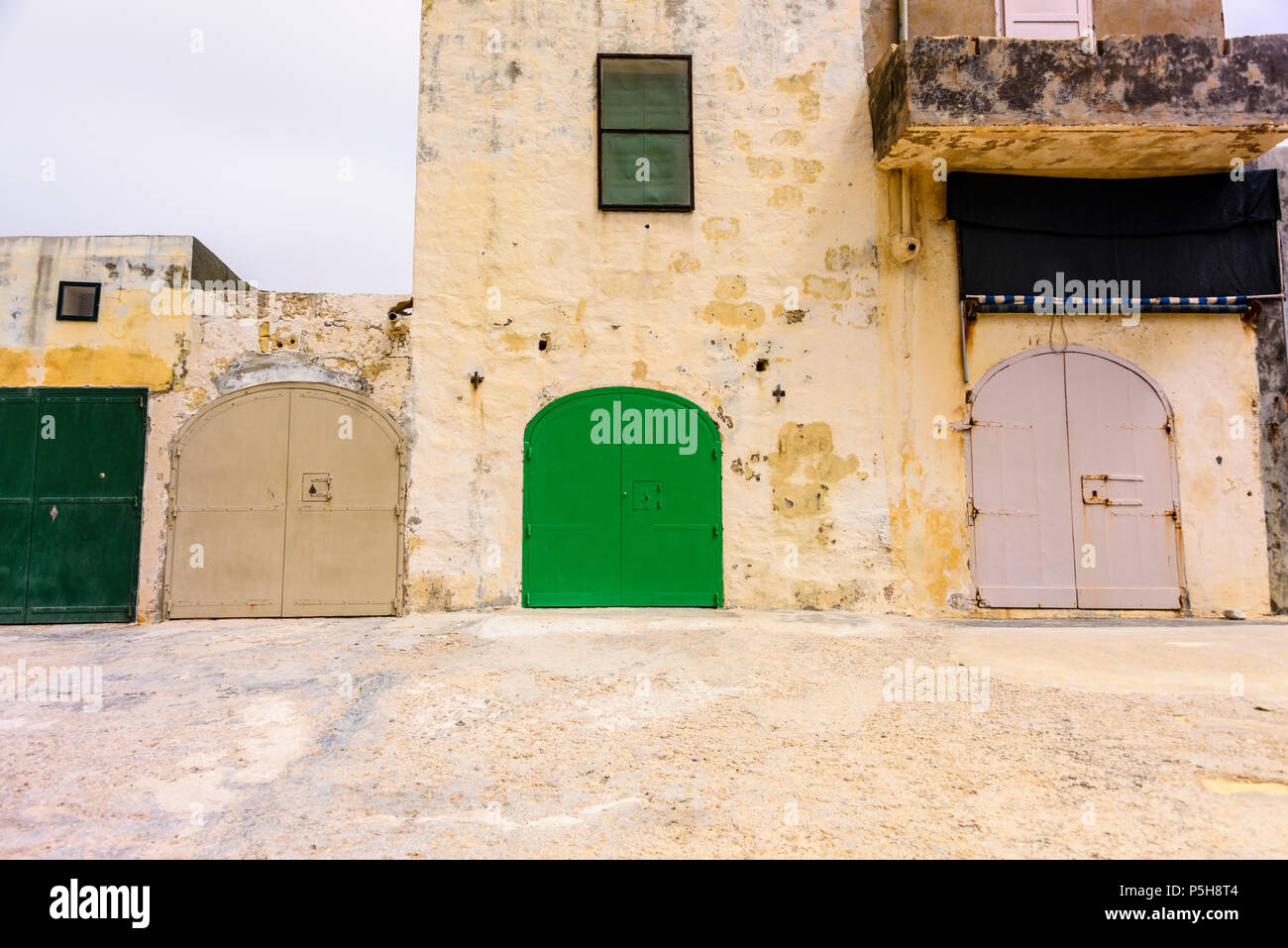 Colourful boat houses at Dwerja, the inland sea, Gozo, Malta. - Stock Image