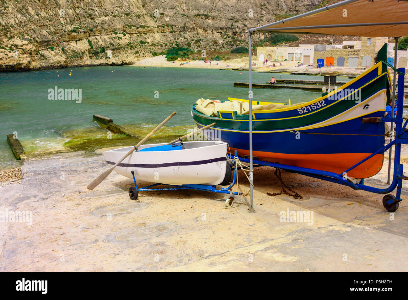 A traditional Maltese clinker boat at Dwerja, the Inland sea, Gozo, Malta - Stock Image