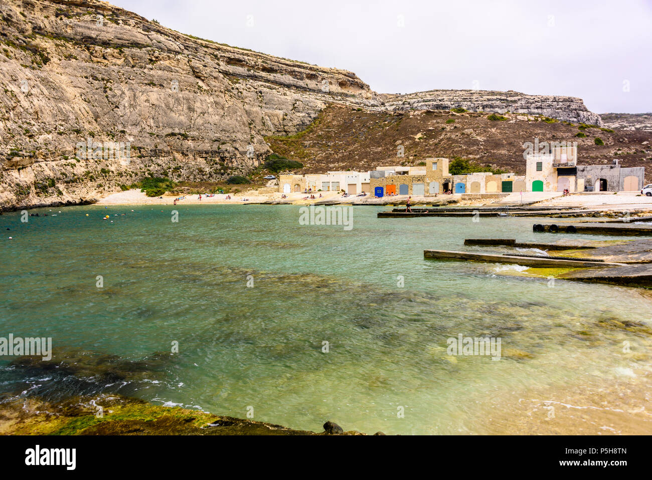 Colourful boat houses at Dwerja, the inland sea, Gozo, Malta. Stock Photo