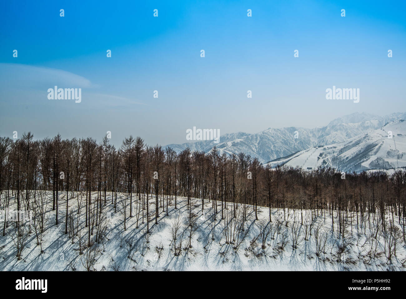 Hakuba ridge in spring. It is famous of the venue for The Nagano Winter Olympics. This area is very popular as ski resort for foreigners. - Stock Image