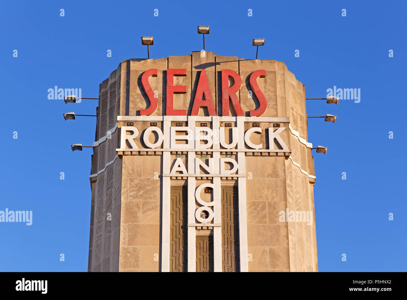 An old Sears Roebuck & Company store sign on a art deco facade - Stock Image