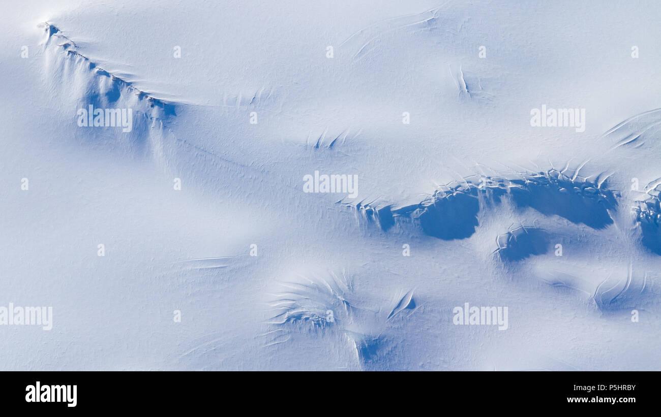 Aerial View of Antarctica, nunataks and crevasses - Stock Image