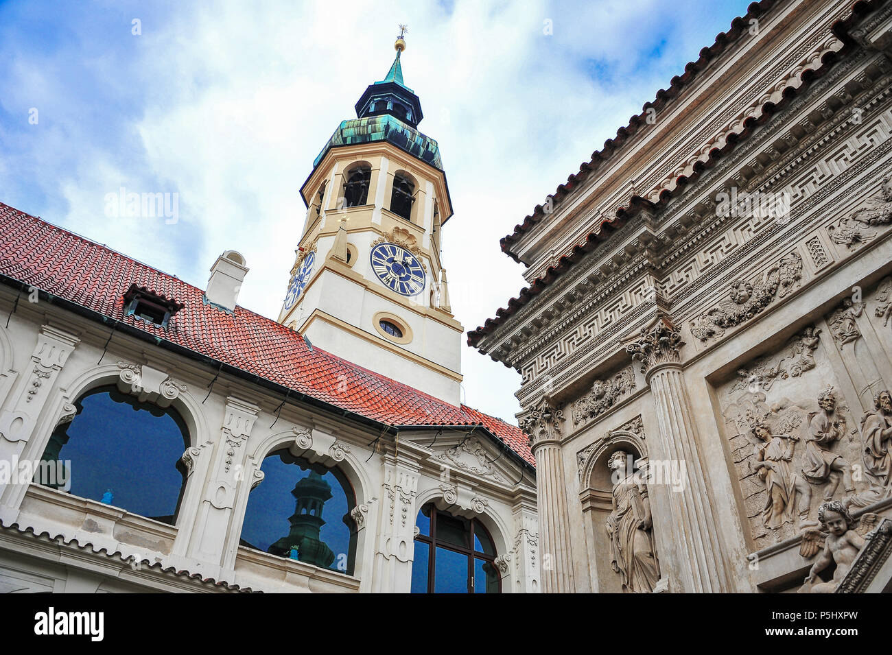 Our Lady of Loreto Church, Prague. Interior courtyard with the Santa Casa (Holy House) and Clock Tower behind. - Stock Image