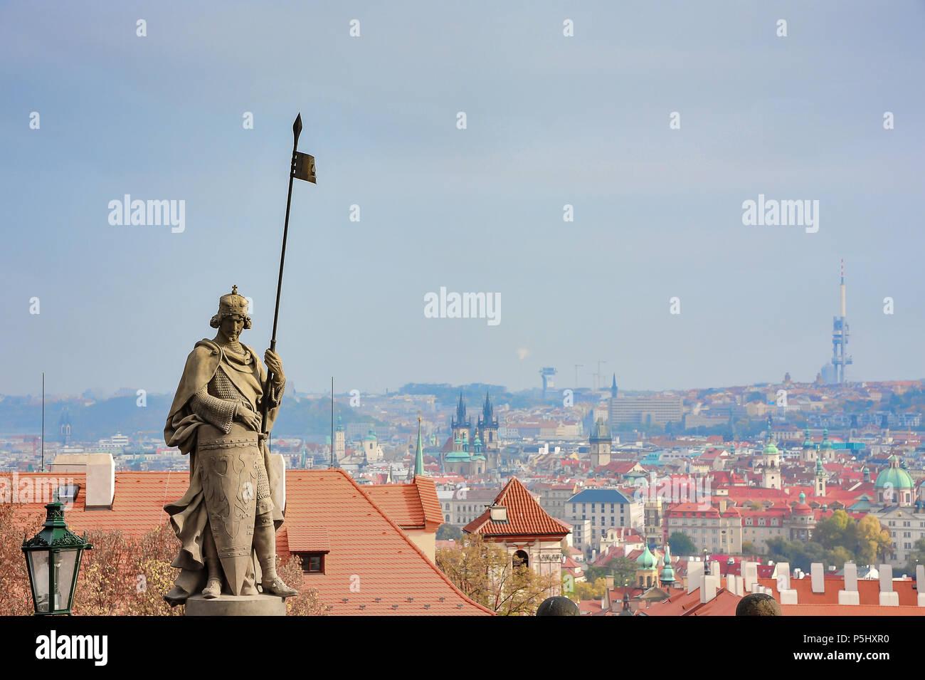 St. Wenceslas statue overlooks Prague city. Sculpture by Cenek Vosmik in Hradcany Square at Prague Castle. Saint with shield and spear against skyline - Stock Image