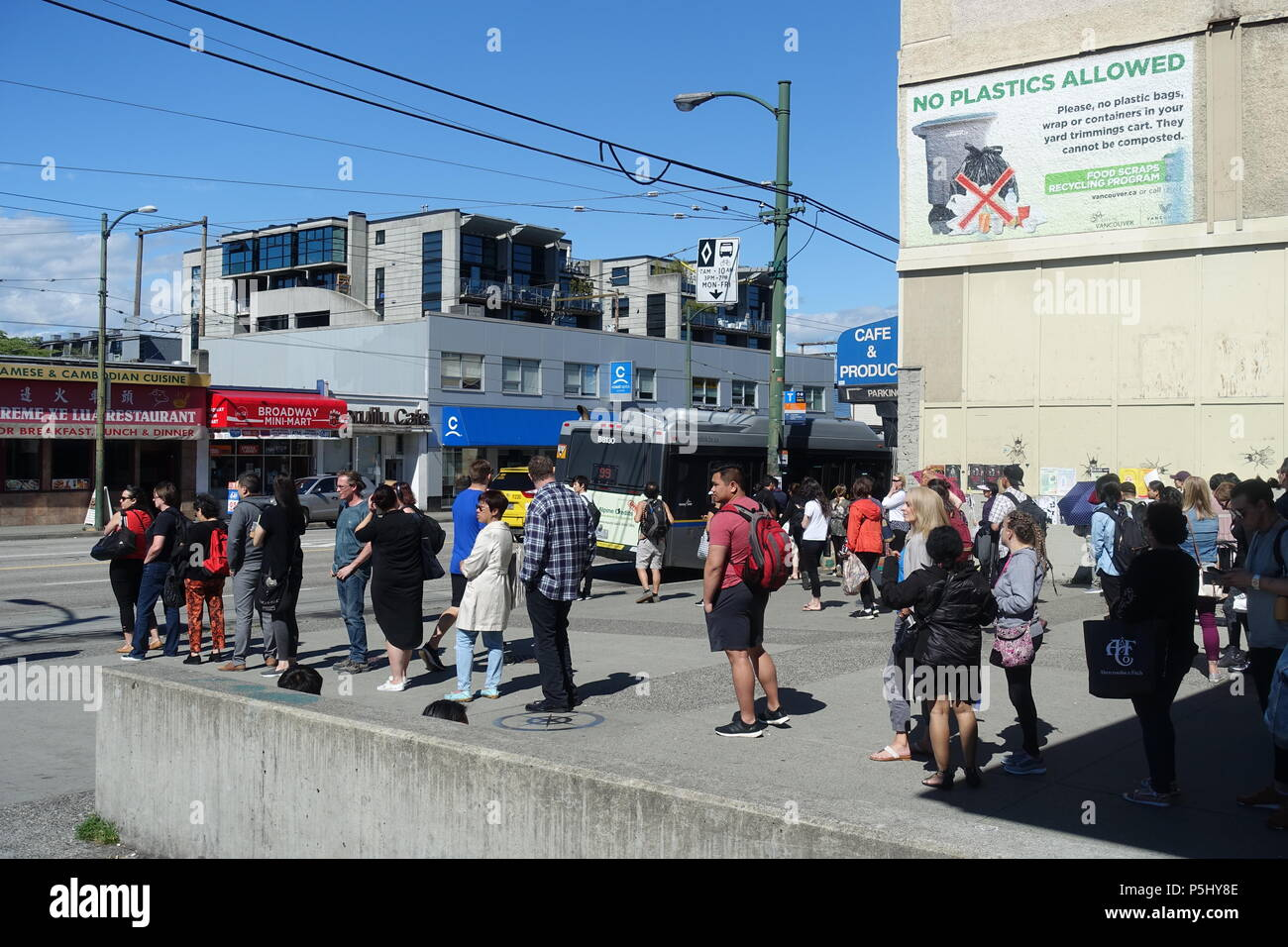 People Line Up In The Bus Stop 99 B Vancouver BC Canada