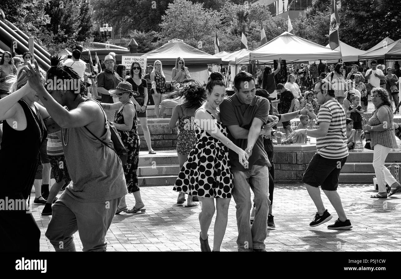 Couples dance at the Hola Asheville Festival, celebrating Latin American culture, in Asheville, NC, USA - Stock Image