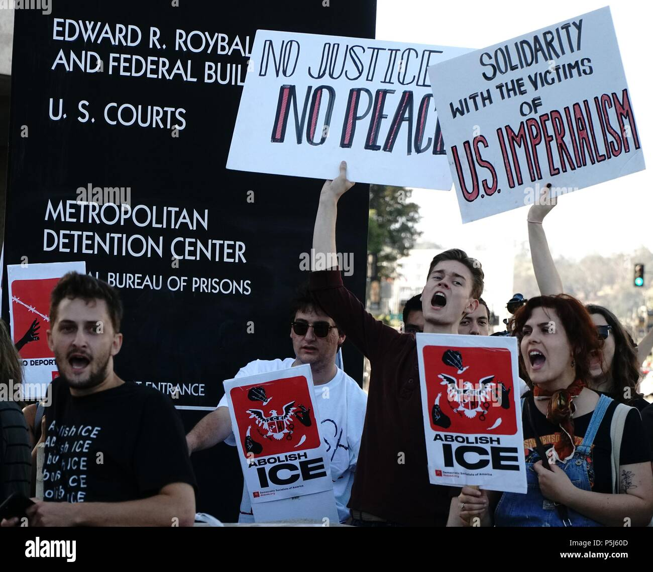 Los Angeles, California, USA. 26th June, 2018. Hundreds of Demonstrators from Democratic Socialists of America and Occupy ICE organizations gather at Grand Park outside City Hall in Los Angeles. Marching to the Los Angeles, Federal Building ICE (Immigration Customs and Enforcement) disrupting traffic from exiting the facility, demanding action to stop the detention of families. Credit: James Tsukano/Alamy Live News - Stock Image