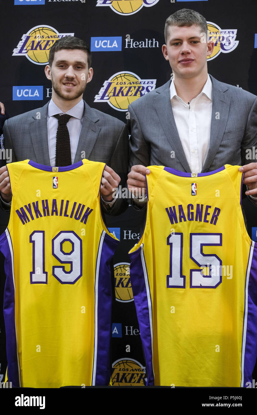 96840e33abc Los Angeles Lakers rookies Sviatoslav Mykhailiuk, left, and Moritz Wagner,  pose with their jerseys at an introductory press conference in Los Angeles,  ...