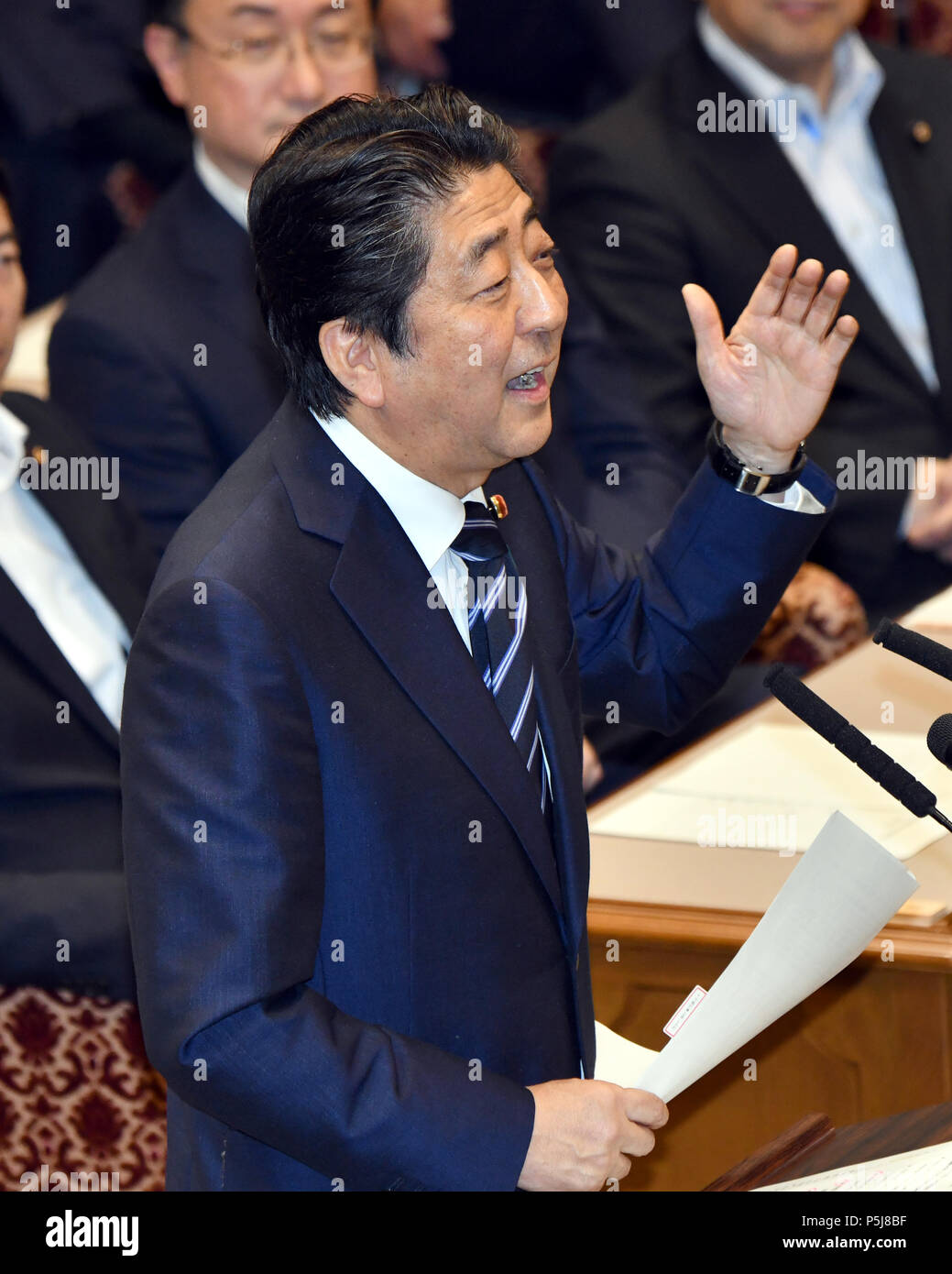 Tokyo, Japan. 27th June, 2018. Japan Prime Minister Shinzo Abe answers Kazuo Shii, leader of the Japanese Communist Party, during a Diet question time of the Joint Review Board of the Committee on Fundamental National Policies in Tokyo on Wednesday, June 27, 2018. Credit: Natsuki Sakai/AFLO/Alamy Live News - Stock Image