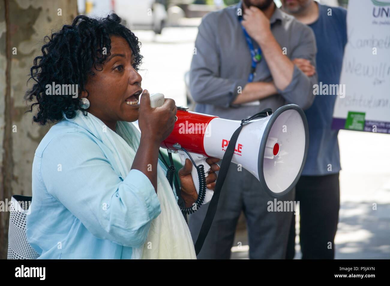 Brixton, London, UK. 27th Jun, 2018. Union member Hassina Malik addresses the assembled workers. ,Lambeth town hall Brixton London UK. Black ethnic minorities workers accuse Lambeth chiefs of not acting fairly in there treatment of BME workers. A lunchtime action was called for by the Unison union, as management haven't responded to complaints or acted on race relations instructions, which is  50 years old this year,UNISON is calling on the current and future governments to renew a commitment to race equality at work and in the wider society. Credit: Philip Robins/Alamy Live News Stock Photo
