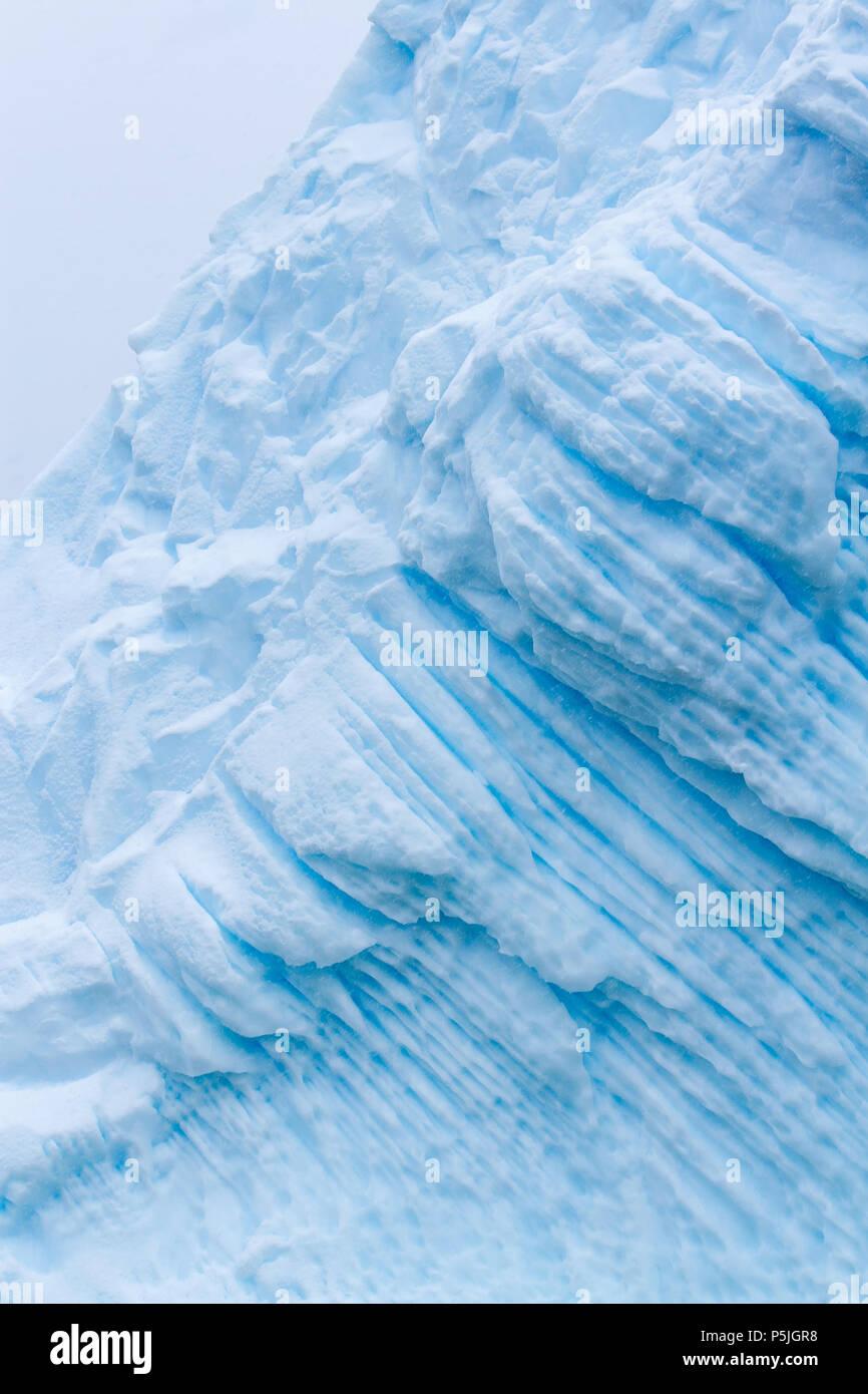 Iridescent blue iceberg detail, Antarctica - Stock Image