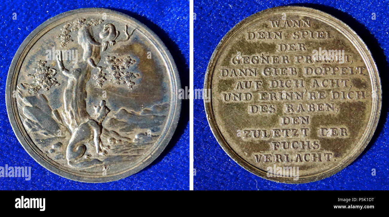 N/A. English: 18th Century, German Whist Game Silver Token showing the Fable The Fox and the Crow (Aesop). Medallion d. = 28 mm. 6.33 g Ag. The fox looking up to the crow./ 12 lines: 'WANN DEIN SPIEL DER GEGNER PREISET, DANN GIB DOPPELT AUF DICH ACHT, UND ERINN'RE DICH DES RABEN DEN ZULETZT DER FUCHS VERLACHT.'. Sommer B 79a. Medallist: L (Daniel Friedrich Loos), 1735 Altenburg an der Pleisse, Germany - 1819 Berlin. Condition: VERY FINE+, old patina. 1 January 1799. Berlin-George 31 18th Century, German Whist Game Silver Token showing the Fable The Fox and the Crow (Aesop) - Stock Image