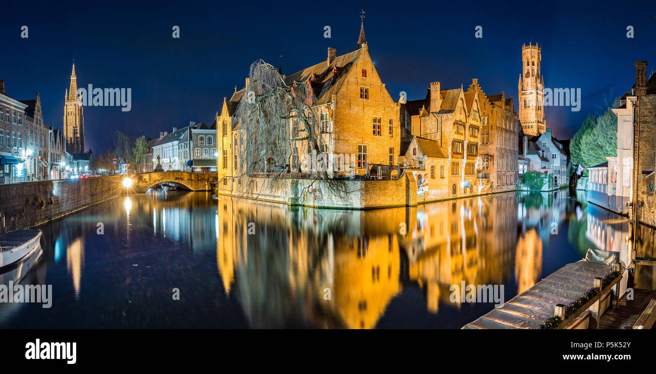 Classic postcard view of the historic city center of Brugge, often referred to as The Venice of the North, illuminated at twilight, Flanders, Belgium - Stock Image